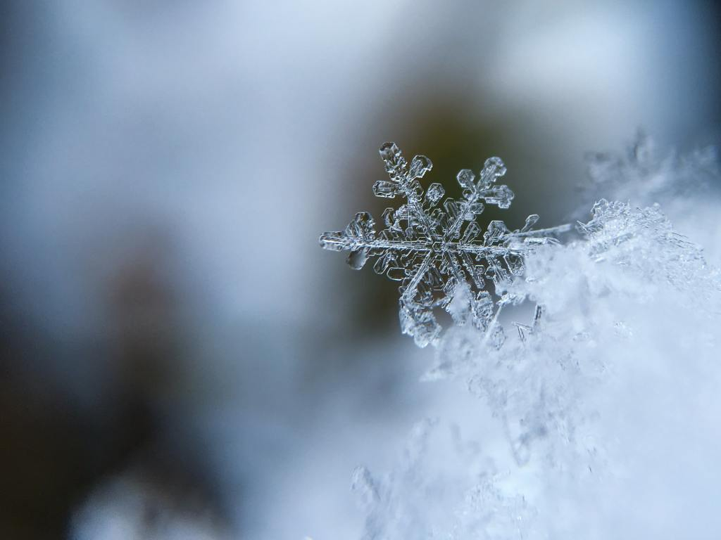 individual snow flake portraying cold weather and frozen pipes